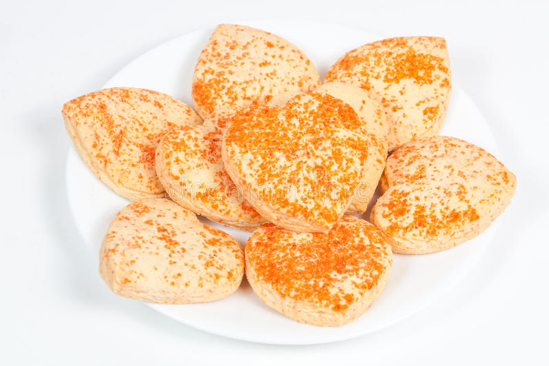 Heart shaped cookies in a plate. Heart shaped cookies in a white plate stock photos