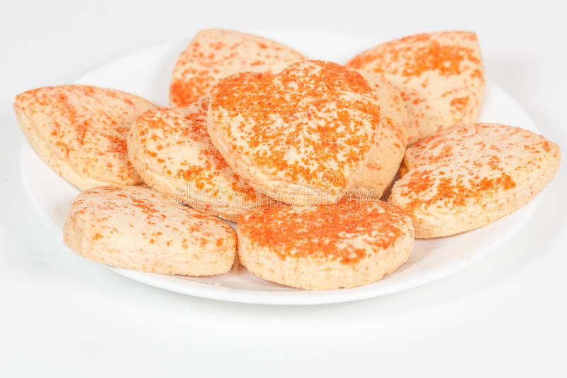 Heart shaped cookies in a plate. Heart shaped cookies in a white plate royalty free stock photography