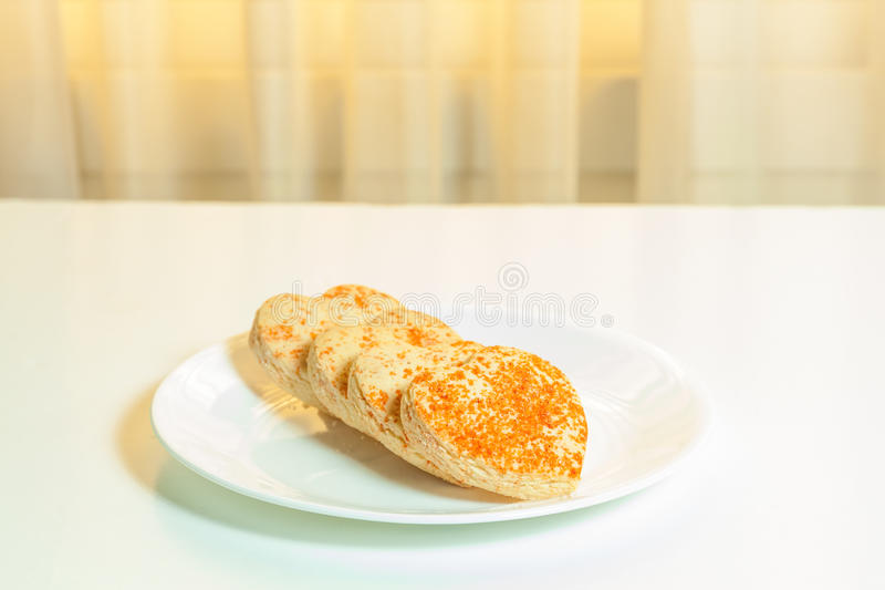 Heart shaped cookies in a plate. Heart shaped cookies in a white plate stock images