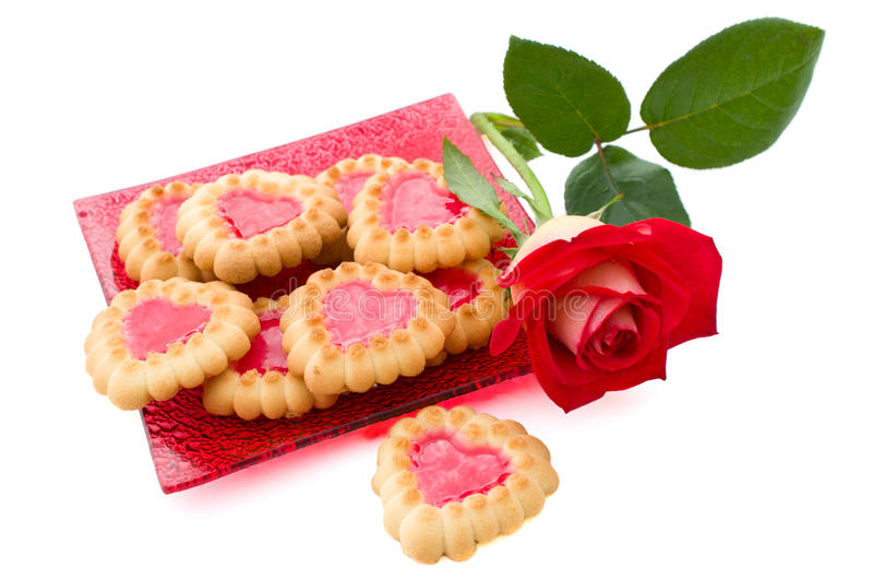 Heart-shaped cookies and rose. Are on a white background royalty free stock photo
