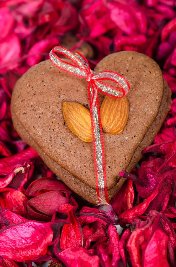 Heart shaped cookies for Valentine's day. Heart shaped cookies with almonds for Valentine's day stock photo