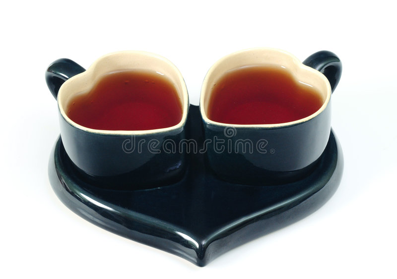 Heart-shaped cups stock photos