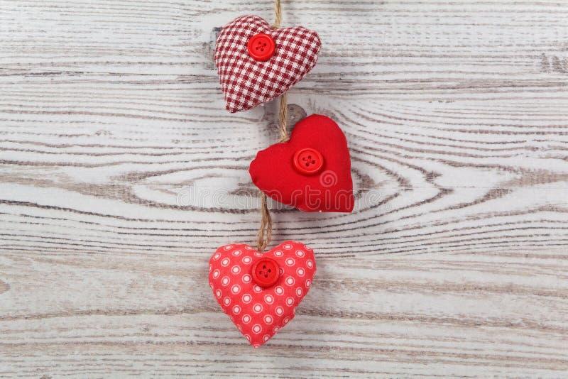 Heart-shaped decoration on wood stock photo