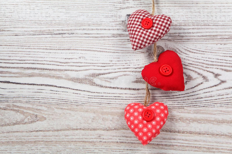 Heart-shaped decoration on wood royalty free stock photos