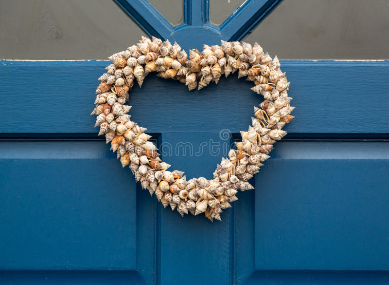 Heart shaped door wreath made from shells stock photo