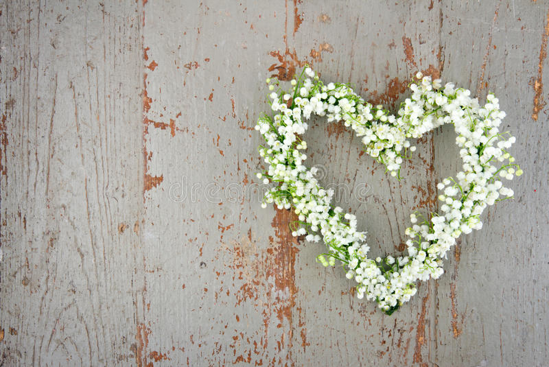 Heart shaped flower wreath of lilys of the valley stock images