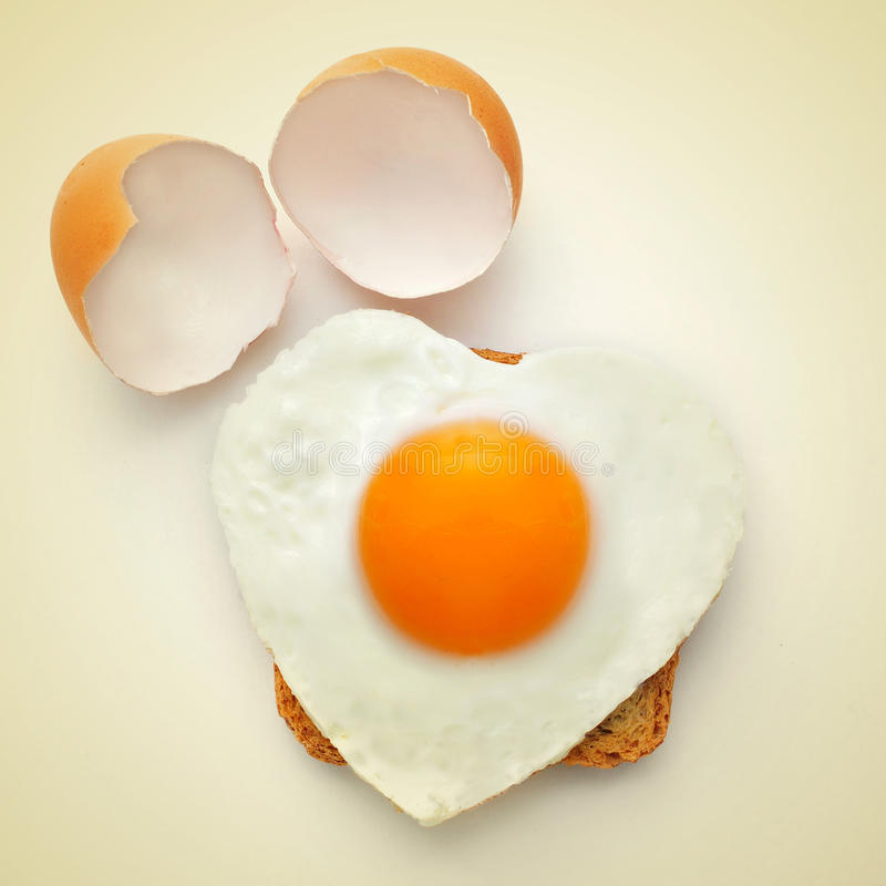 Heart-shaped fried egg stock images