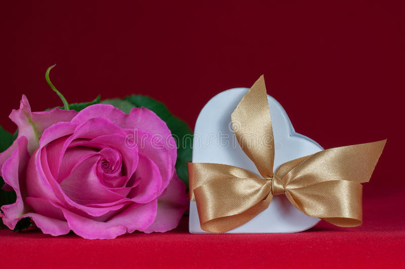 Heart shaped gift box with  pink rose