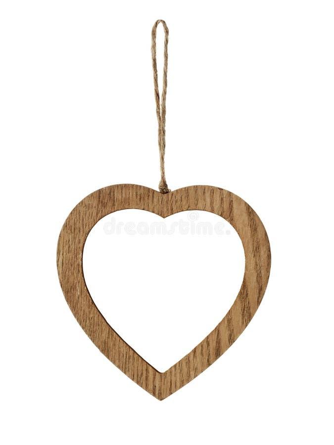 Heart-shaped hölzerner Bilderrahmen lizenzfreie stockbilder