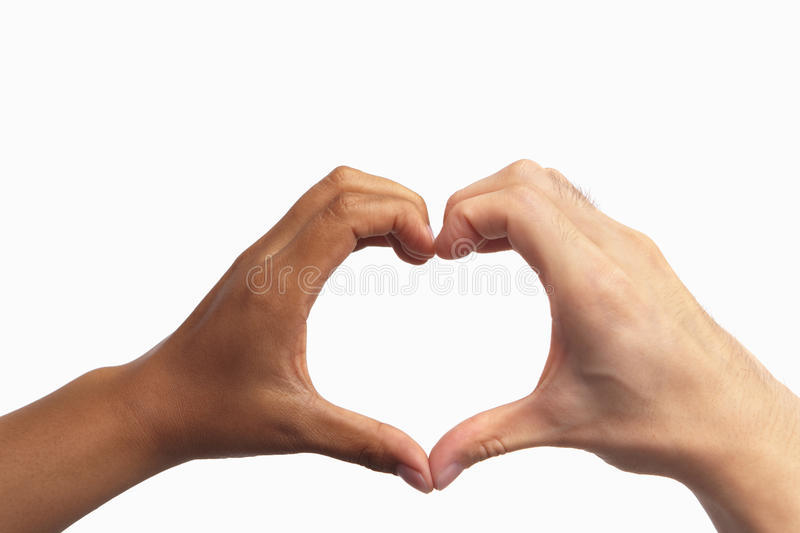 Heart shaped hand gesture. From two different race people royalty free stock photos