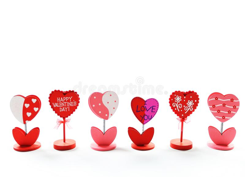 Heart shaped, happy Valentine`s Day note holder on white background. stock photo