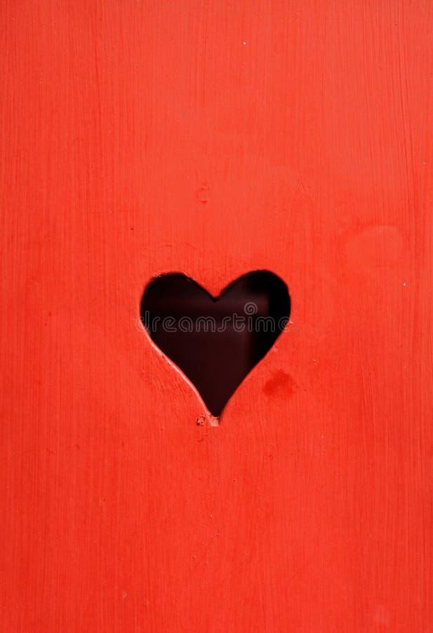Heart shaped hole royalty free stock image