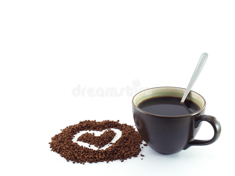 heart shape drawing on soluble instant coffee powder and black coffee with silver tea spoon in dark brown ceramic cup royalty free stock image