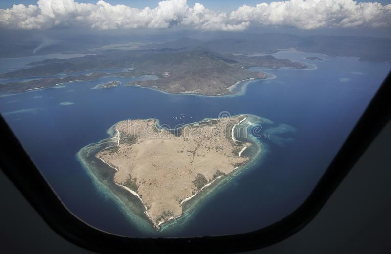 Heart shaped island viewed from plane in Nusa Tenggara, Indonesia. Heart shaped tropical island viewed from plane in Nusa Tenggara, Indonesia, Southeast Asia royalty free stock images