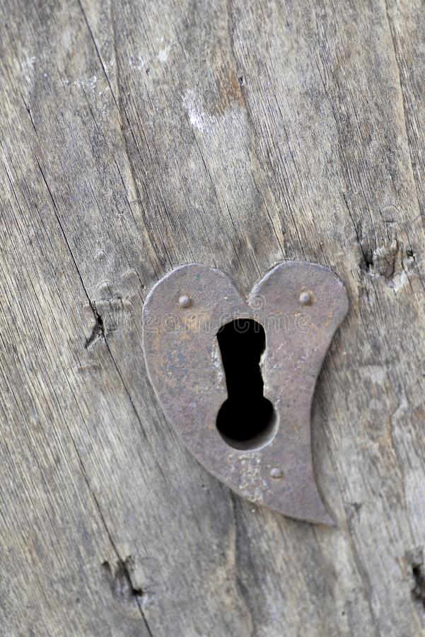 Heart-shaped lock. Old door with lock royalty free stock images
