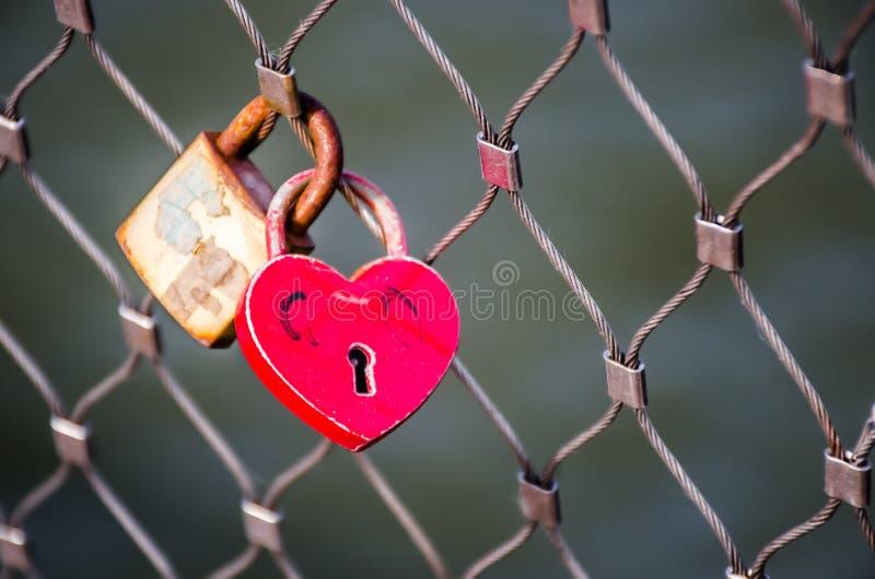 Heart shaped locks on a bridge fence. royalty free stock images