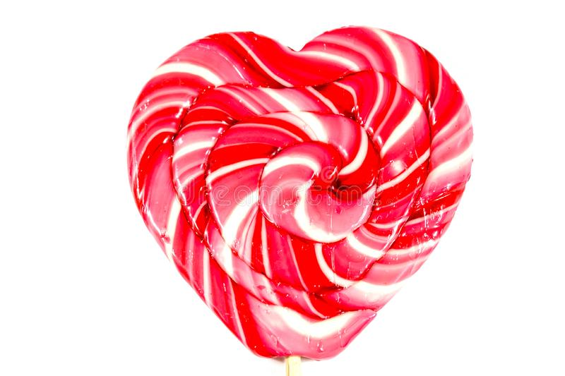 Heart-shaped lollipop isolated on a white background. Heart-shaped lollipop isolated on white background stock photos