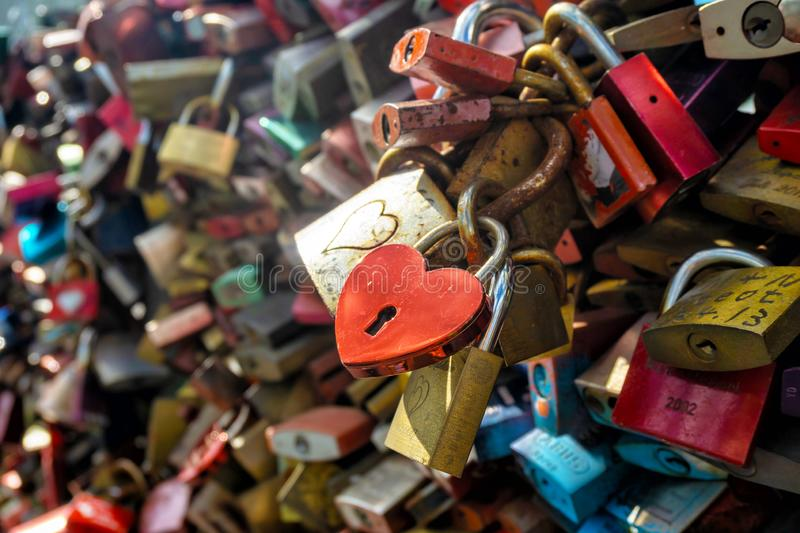 Heart shaped love lock. Heart-shaped love lock hanging on a bridge in Cologne, Germany. Valentine`s Day background stock image