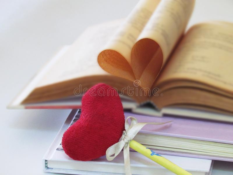 Heart shaped made of old book pages and bookmark red heart is something that must be used together stock images