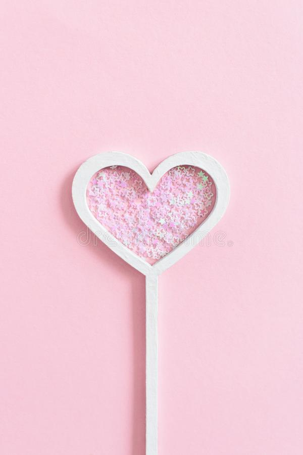 Heart shaped magic wand with star sequins stock photo