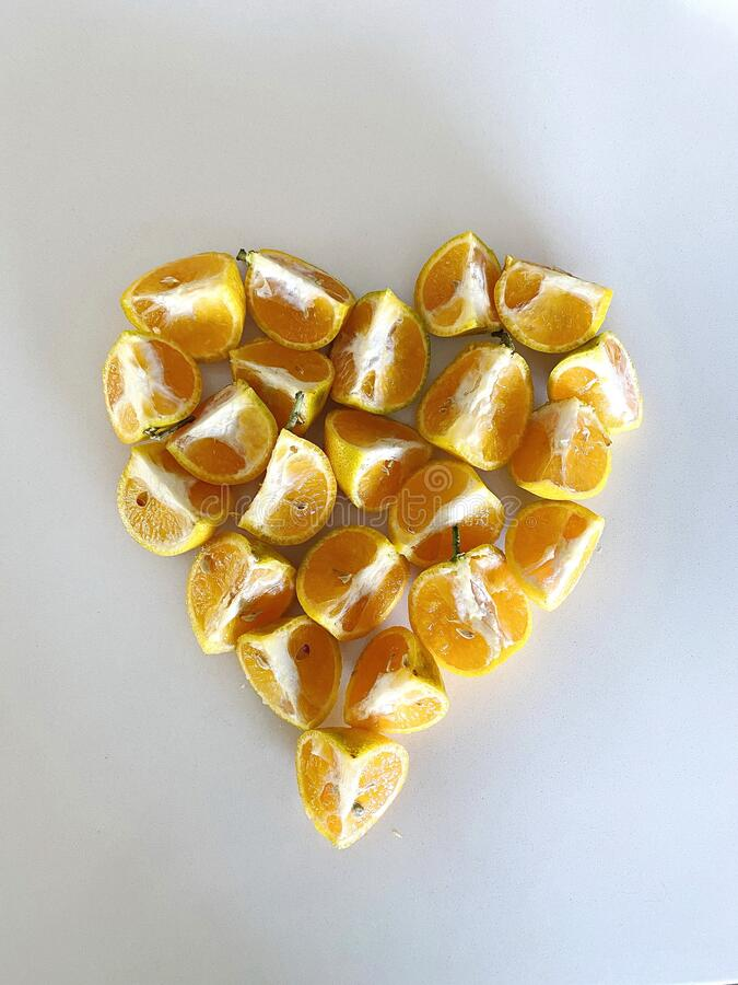Heart Shaped Mandarin Oranges on White Background stock images