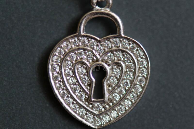 Heart shaped necklace with keyhole stock photos