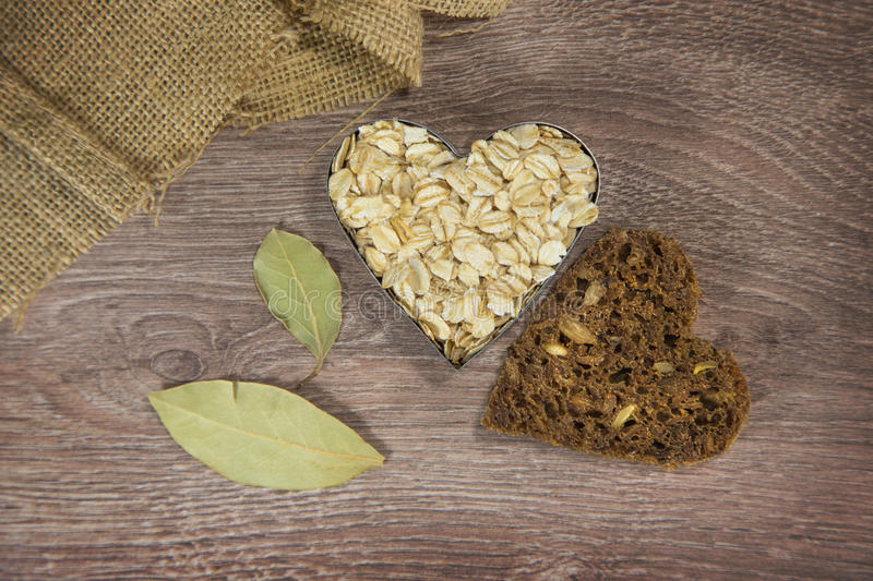 Heart shaped oats and bread stock image