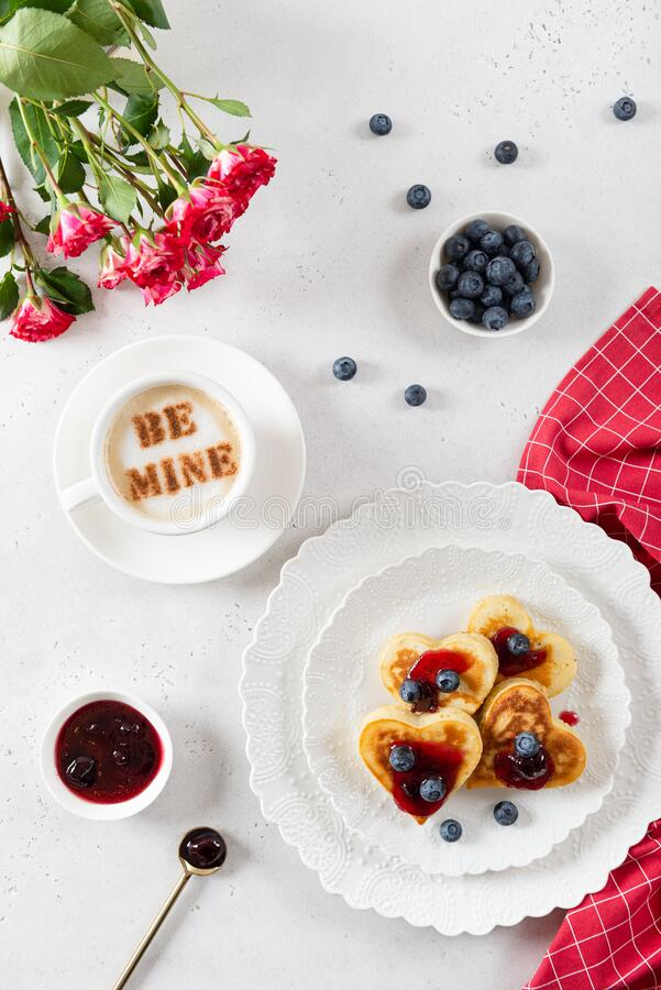 Free Heart Shaped Pancakes And A Cup Of Coffee On A White Background. Festive Breakfast For Valentine`s Day, Sweet Valentine. Poster, Royalty Free Stock Photos - 170555708