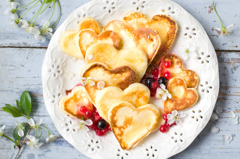 Heart shaped pancakes royalty free stock image
