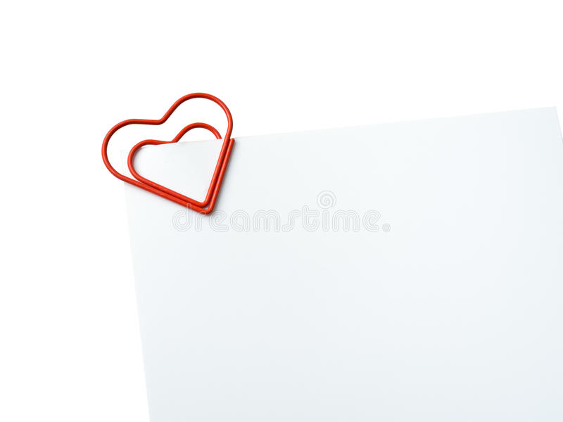 Heart shaped paper clip holding blank glossy photo stock images