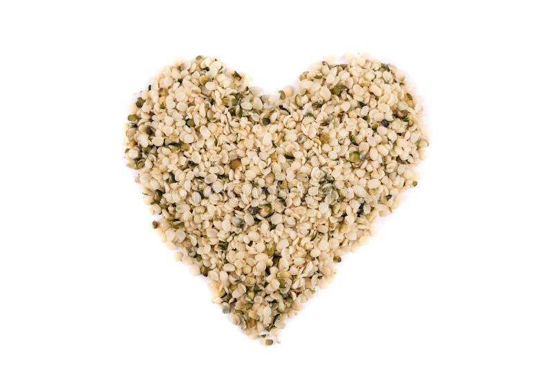 Heart shaped pile of hemp hearts stock photo