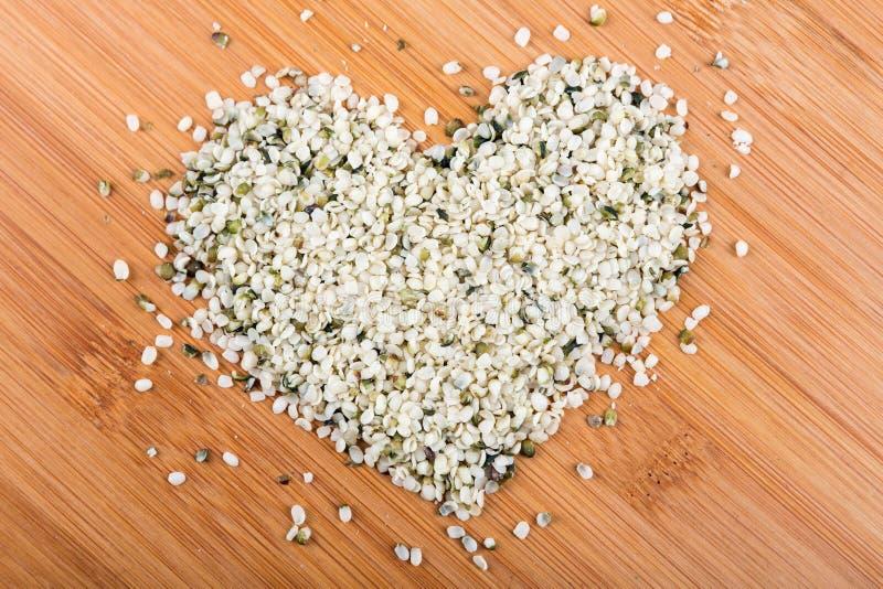 Heart shaped pile of hemp hearts stock photos