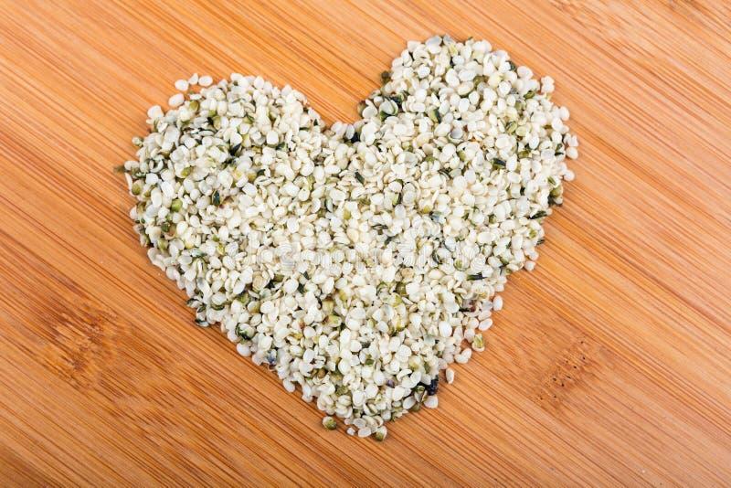 Heart shaped pile of hemp hearts stock image
