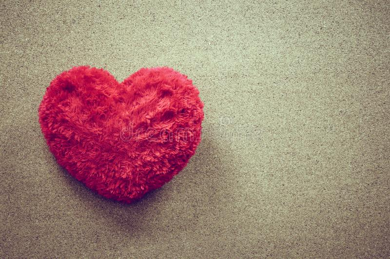 Heart shaped pillow on wood background for valentines day, vintage style stock image