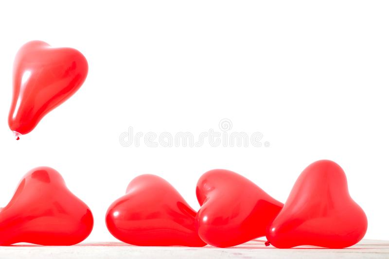 Heart shaped balloons isolated on white background. Heart shaped red balloons isolated on white background royalty free stock images
