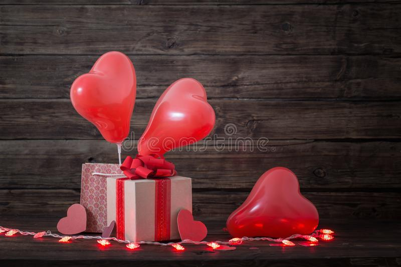 Heart shaped balloons on wooden background. Heart shaped red  balloons on old wooden background royalty free stock photo