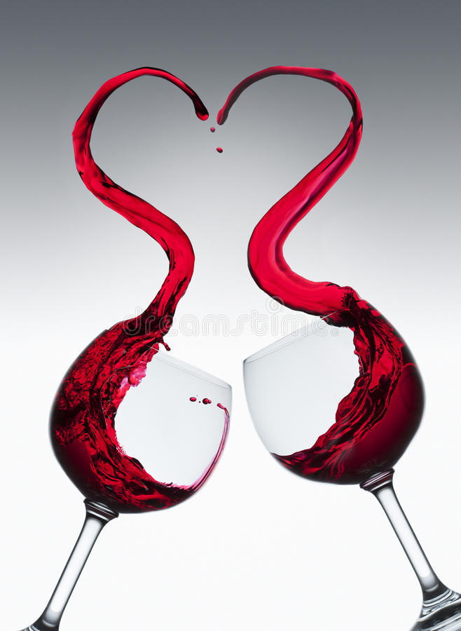 Heart shaped red wine splash stock images