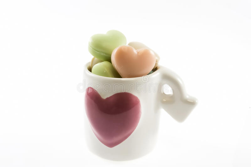Heart shaped soaps in cup royalty free stock photo