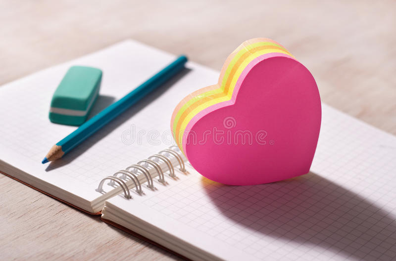 Heart shaped stickers on note book royalty free stock photos
