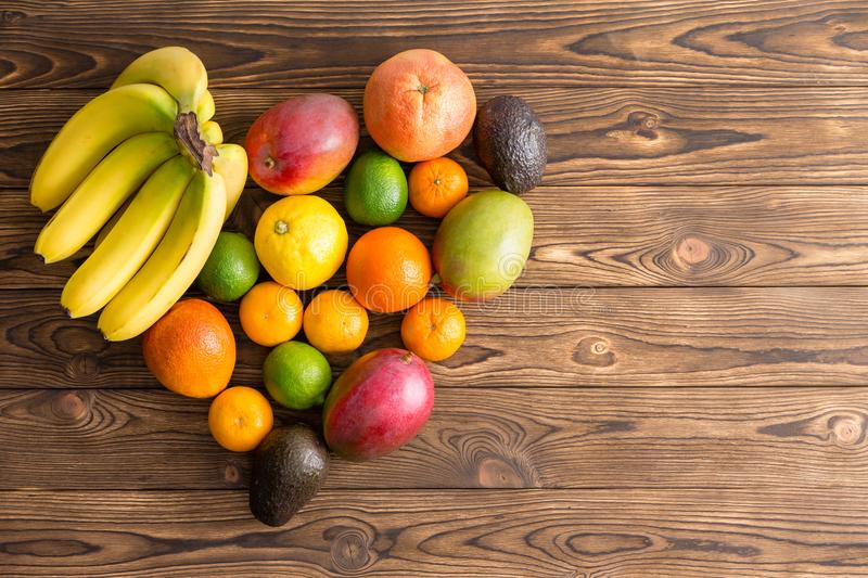 Heart-shaped still life of mixed tropical fruit royalty free stock images