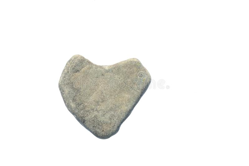 Heart shaped stone. man with stone heart. concept of cruel, callous, indifferent person. Heart shaped stone. man with a stone heart. concept of cruel, callous stock photo
