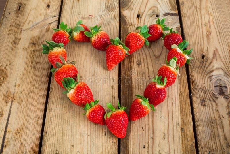Heart shaped strawberries stock photos