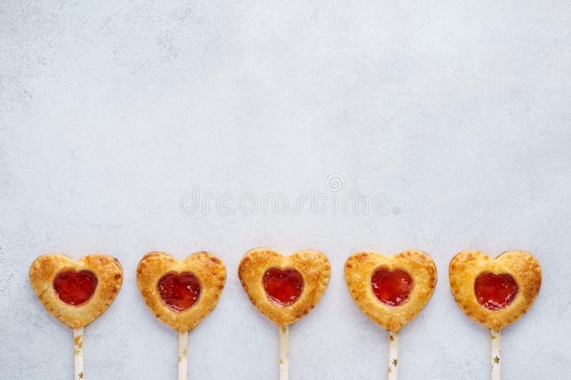 Heart shaped strawberry pie pops for Valentines Day royalty free stock photos