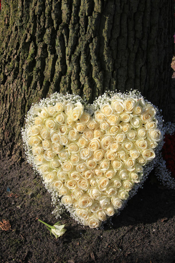 Heart shaped sympathy flowers royalty free stock images