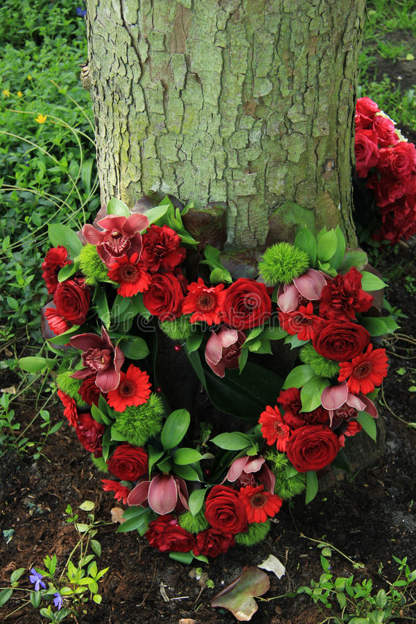 Heart shaped sympathy flowers. Red roses in a heart shaped sympathy arrangement royalty free stock image