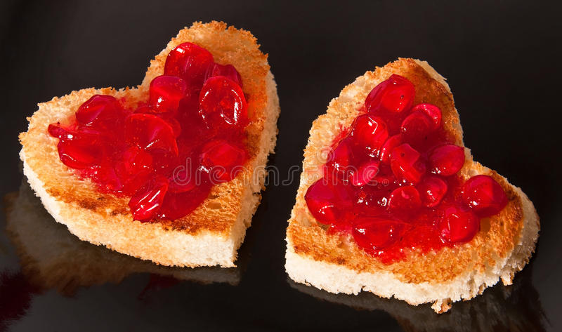 Heart shaped toast. With jam royalty free stock photography