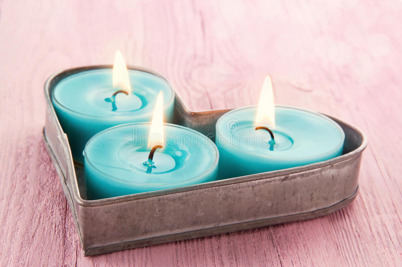 Heart shaped tray with romantic candles stock photo