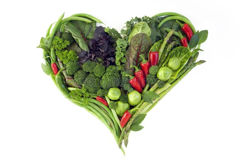 Vegetables in the shape of a heart  on a white background royalty free stock photo