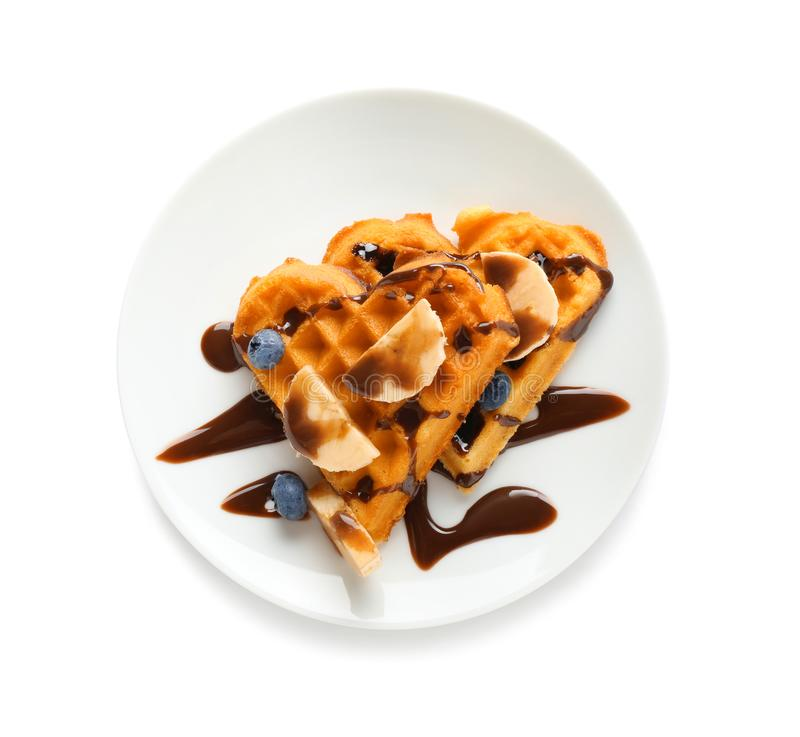 Heart shaped waffles with banana, blueberries and chocolate sauce on white background stock photo