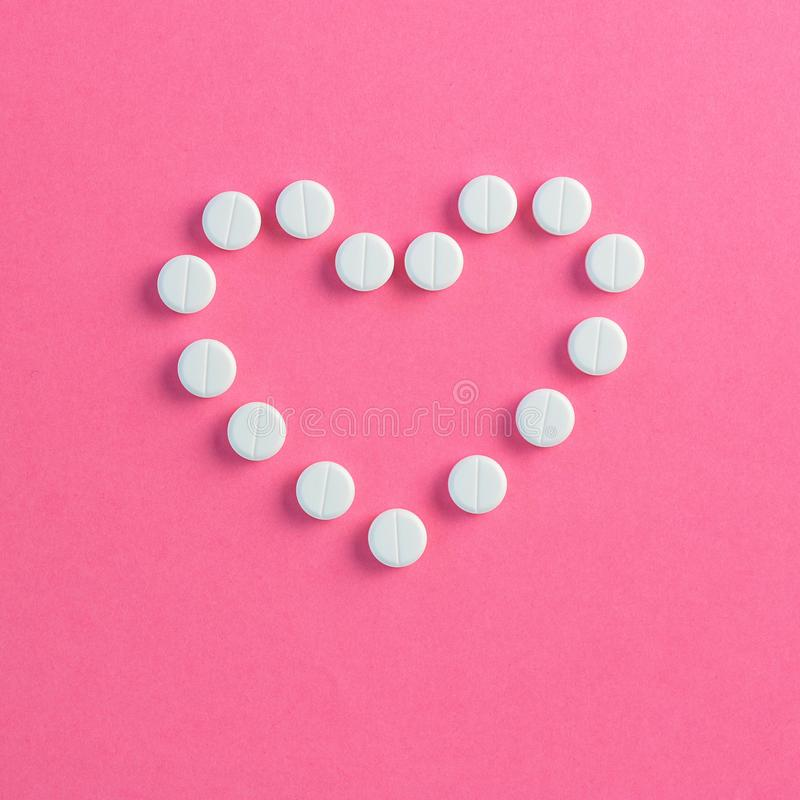 Heart shaped of white pills royalty free stock photography